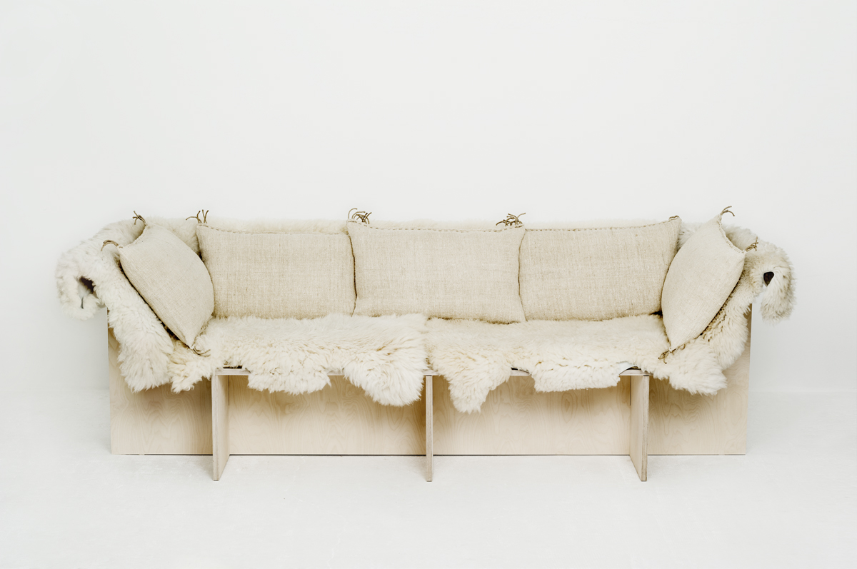 Sofa from Les Foins with sheepskins