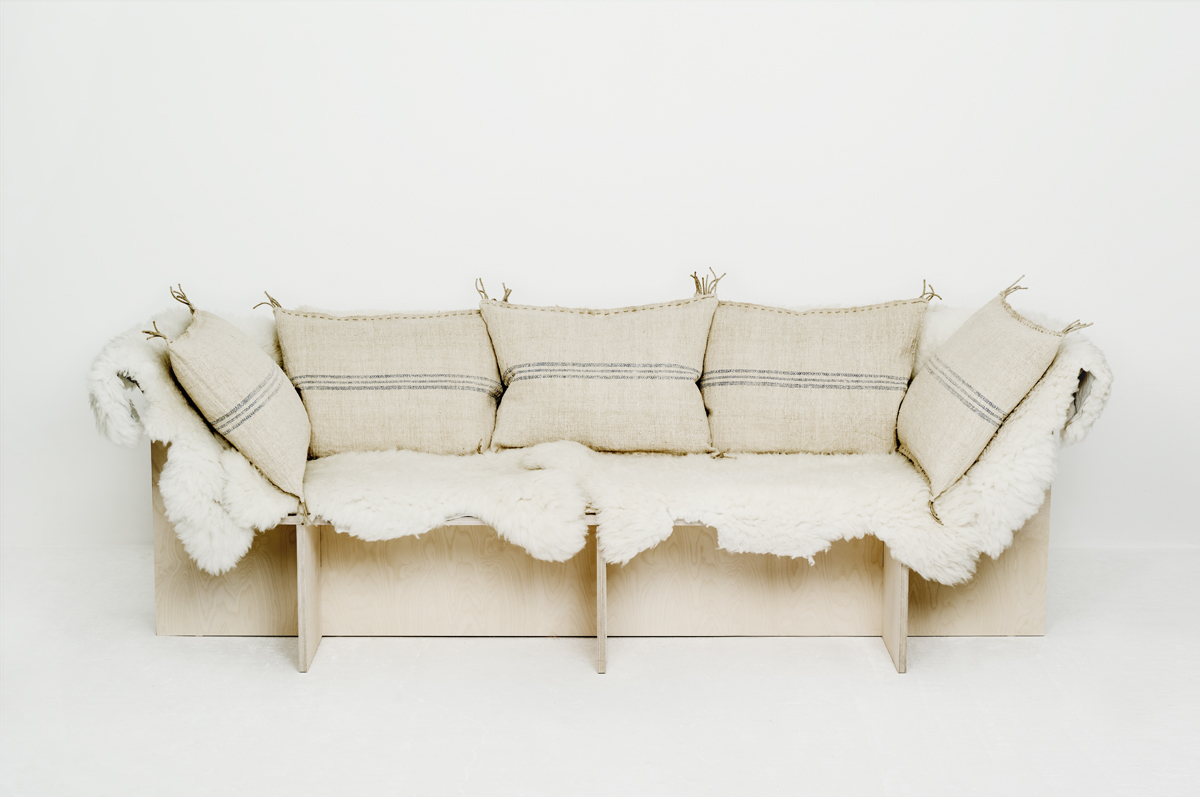 Sofa from les Foins Blue with sheepskins